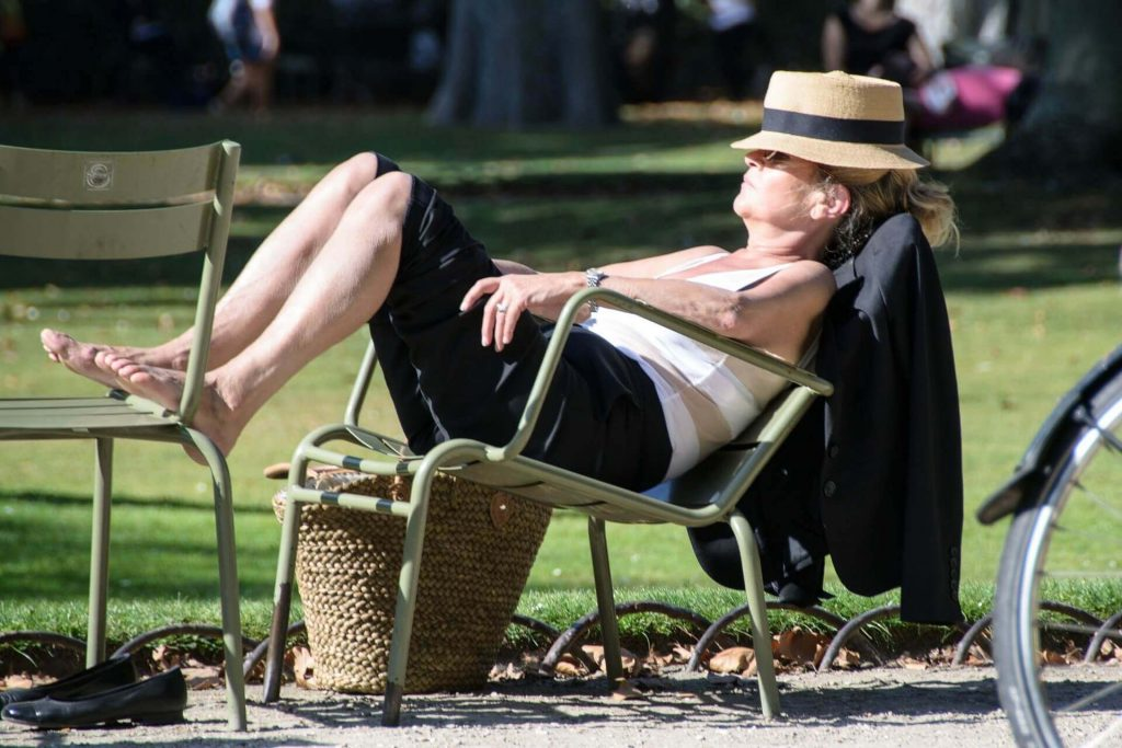 a woman reesting in the sun recuperating from jet lag