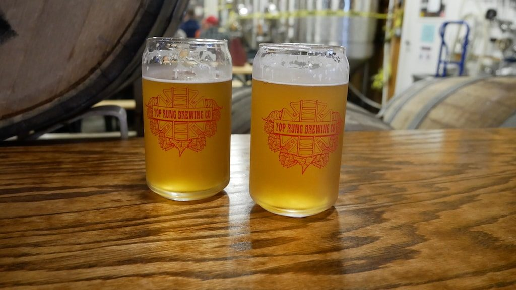 2 glasses of beer on a Brewery Road Trip