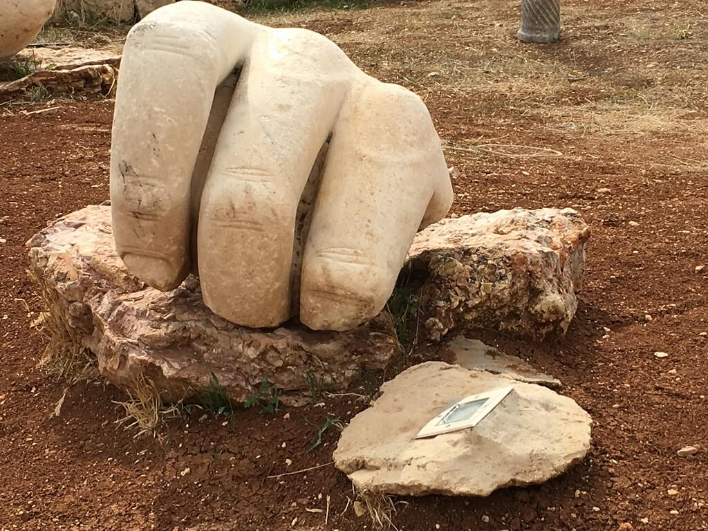 Visit the citadel with the giant hand sculpture. One of the best things to do in Amman, Jordan