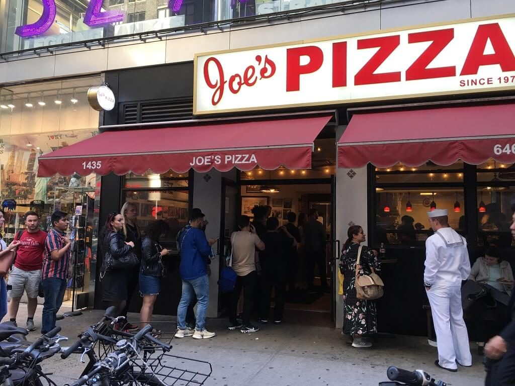 Joe's Pizza storefront. One of the famous places to eat in New York City