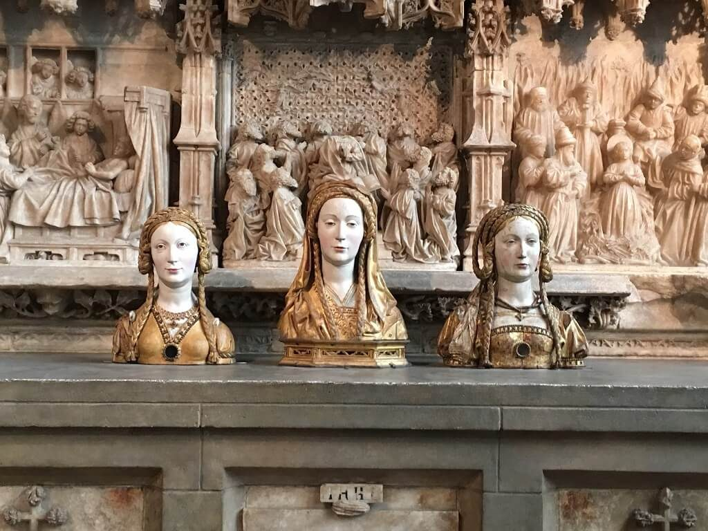 three female artistic heads at the Cloisters, one of the most underrated attractions in NYC