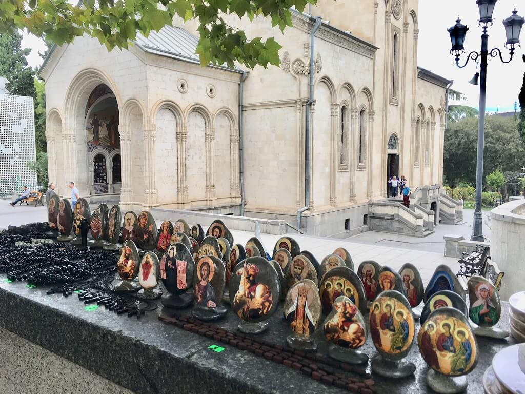 Tbilisi church with icons for sale.
