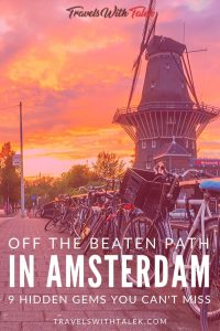 A Street in Amsterdam with bikes and a windmill