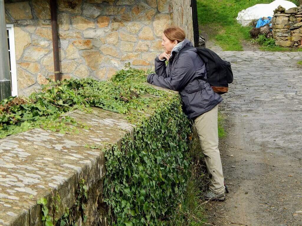 woman looking over bridge on the Camino de Santiago