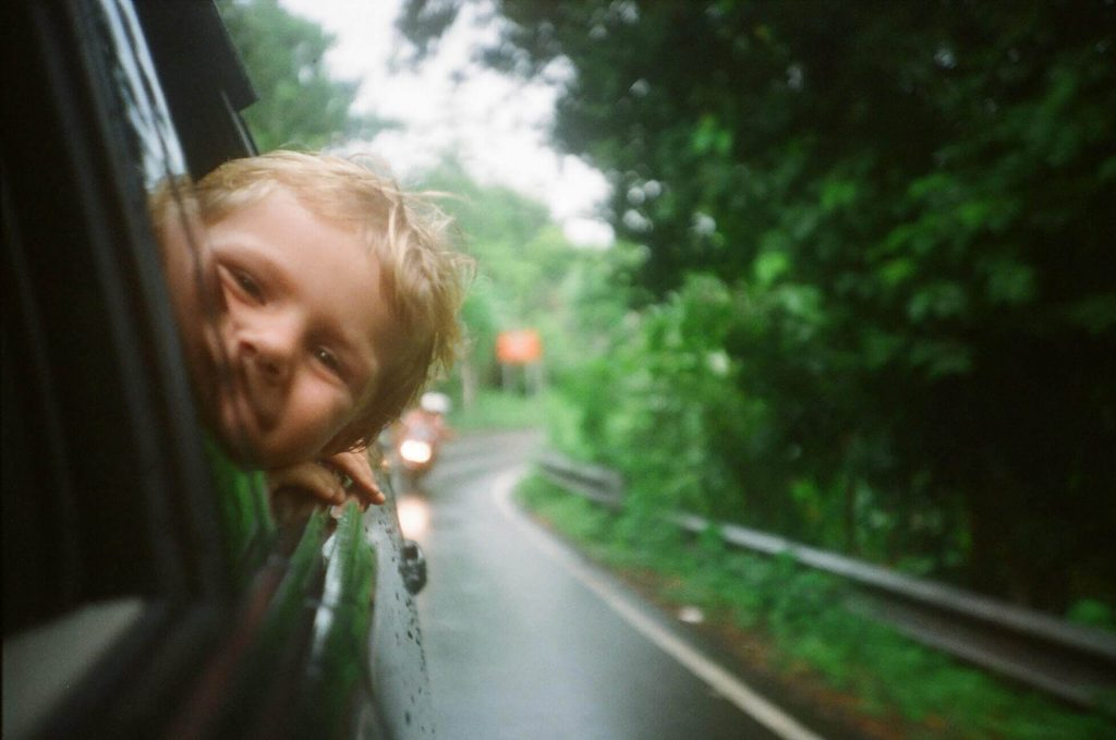 child looking out of a car