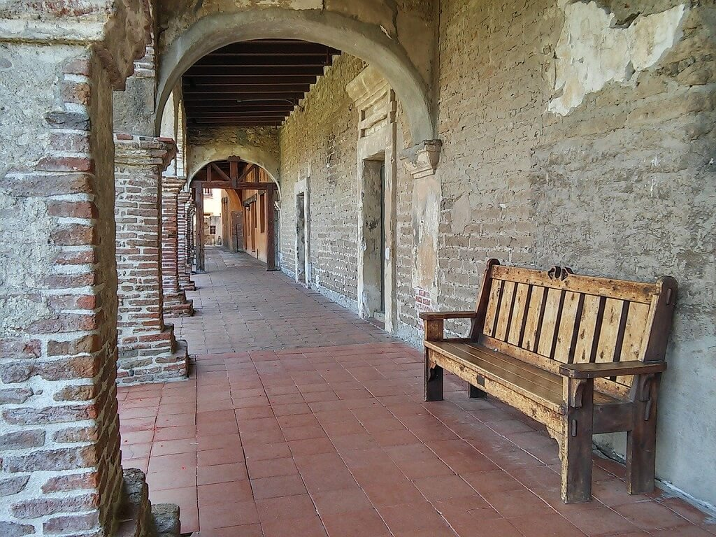 California mission walkway with bench