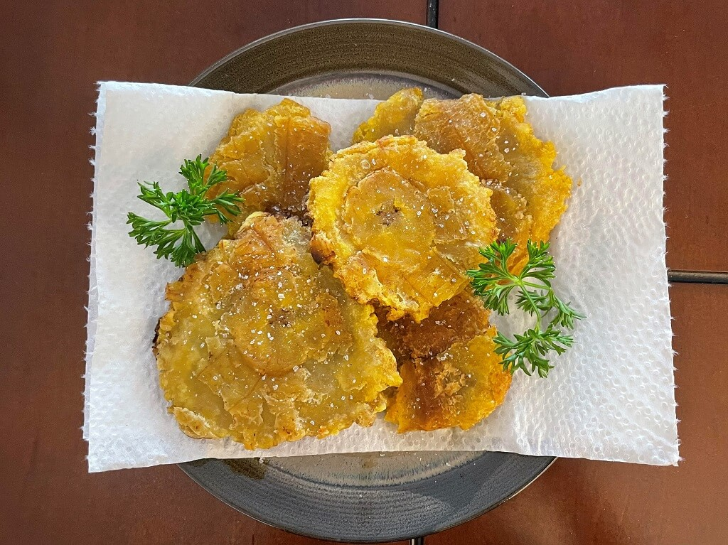 a plate full of fried plantains
