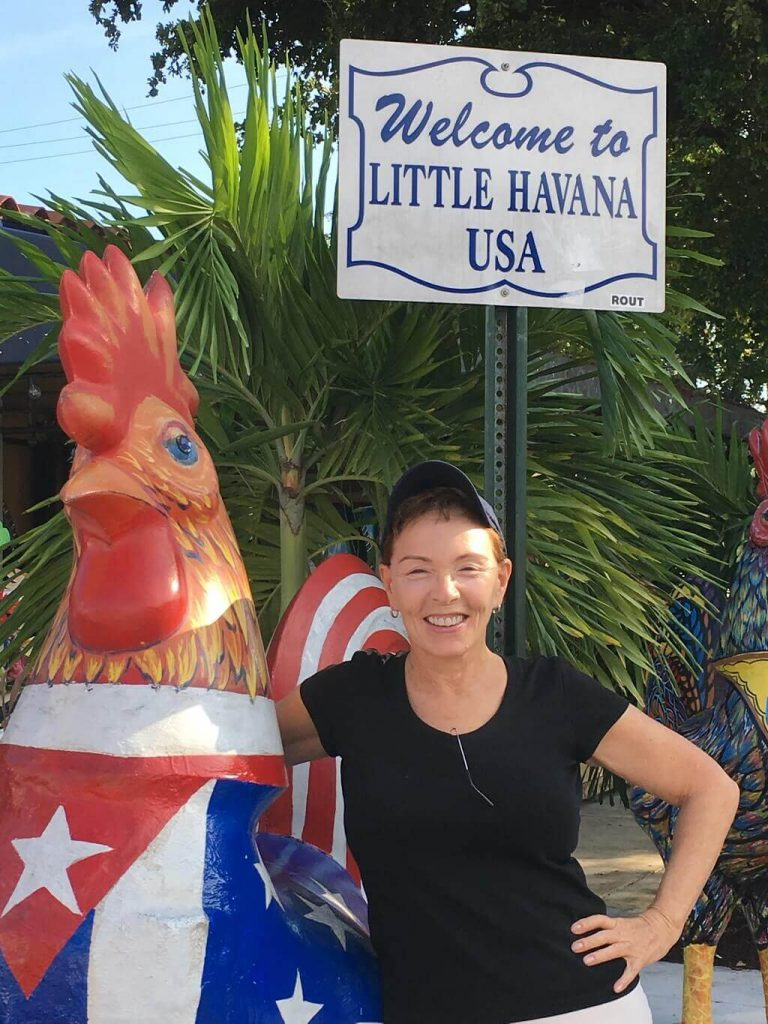 Talek Nantes and a rooster statue in Little Havana.