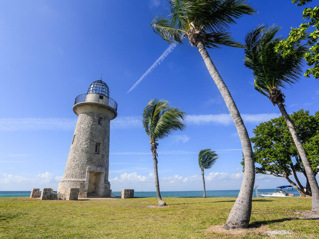 Lighthouse and palm trees on Biscayne Bay near Miami.