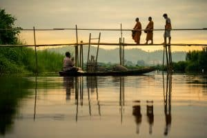 shallow focus photo of people crossing a bridge