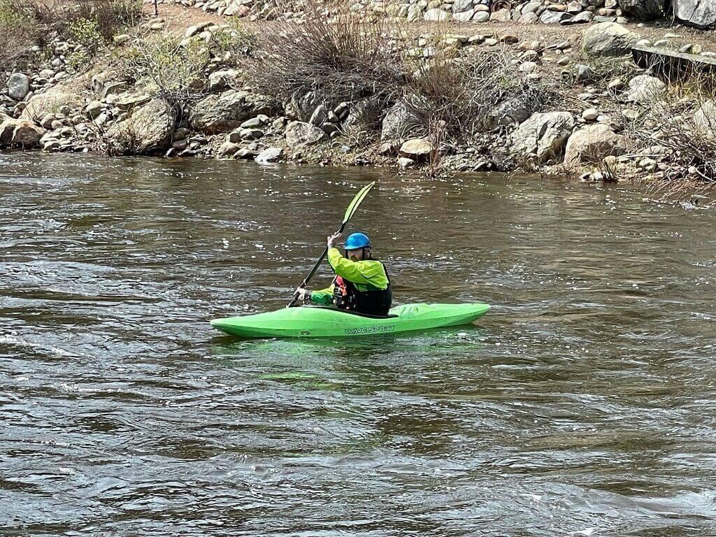 Man in kayak on river seen on a Colorado to Utah road trip