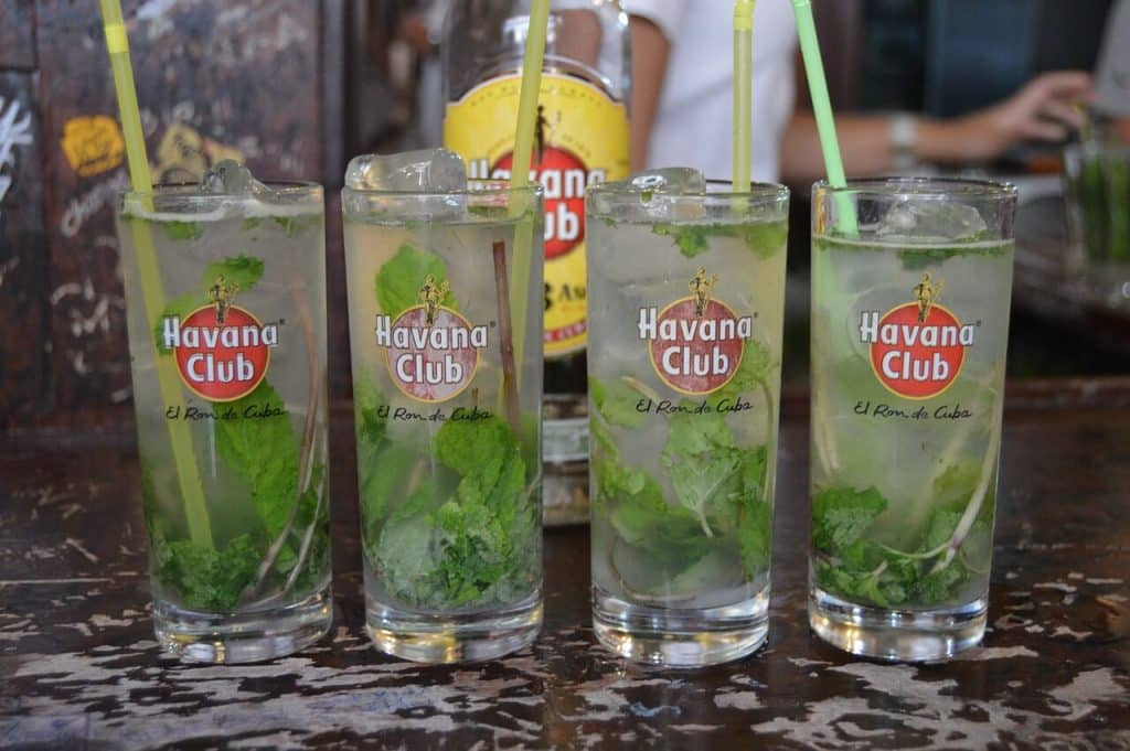 Four tall glasses of mojitos, a legendary cocktail form Cuba